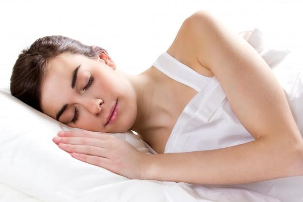 female sleeping in bed