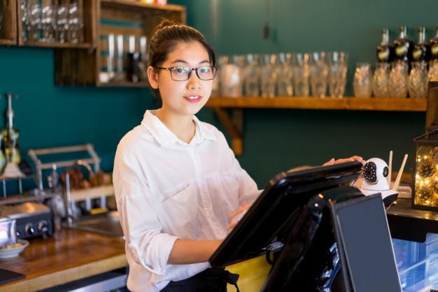 smiling cashier at work
