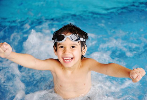 little cute boy swimming in the pool