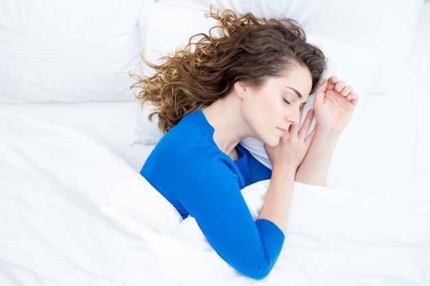 woman side sleeping in bed