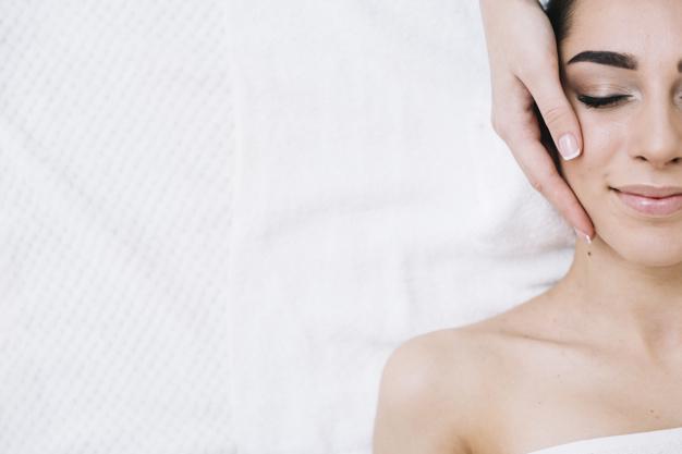 woman having a relaxing facial