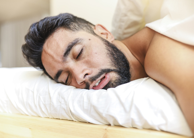 man sleeping in stomach position