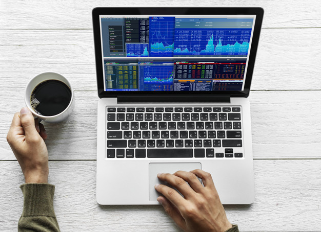 Person using laptop for stock trading