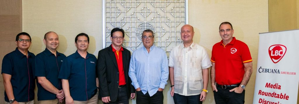 Photo shows Cebuana Lhuillier and LBC Express, Inc. executives (from L-R): Filemon Cecilio Cabungcal, Deputy Chief Finance Officer, Jose Miguel Jimenez, Head of Pawnshop Operations & Group Head, Ergilio Ong, Senior Vice President, Head of ICT, and Product Management Groups, Oliver Valentin, Mr. Oliver Valentin, EVP and COO for Philippine Branch Operations of LBC Express Inc., Miguel Angel A. Camahort, President and CEO of LBC Express Inc., Jean Henri Lhuillier, President and CEO of Cebuana Lhuillier, and Javier Mantecon, Chief Marketing Officer of LBC-Express Global Marketing