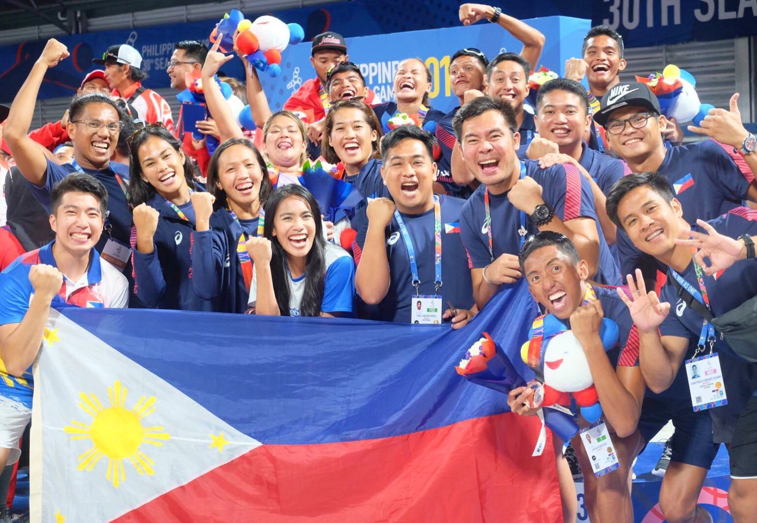 Sports enthusiasts and volleyball fans cheer for the Philippines' finest athletes competing at the SEA Games in Manila