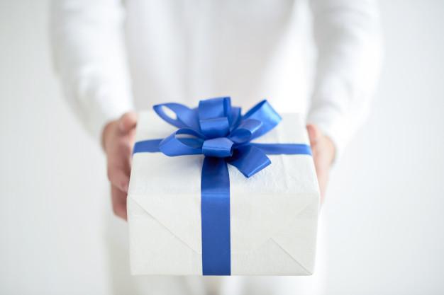 hand giving gift