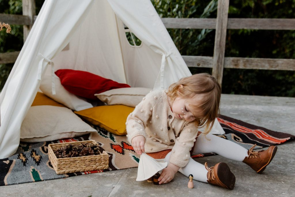little girl in a teepee tent